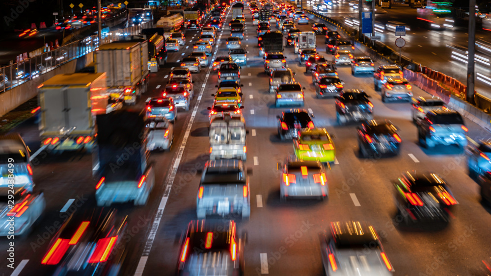 Blurred zoom image of traffic jam in the city at night