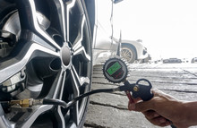 Selective Focus Of Hand Man Holding Digital Tire Pressure Gauge To Inspection Measure Quantity Proper Tire Inflation For Car