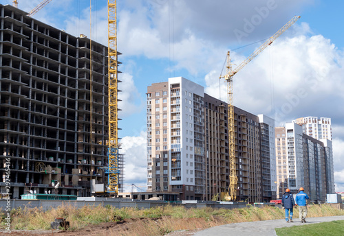 High rise building with cranes under construction Wallpaper Mural