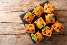 Halloween Pumpkin Blondies With Chocolate Drops And Mint Closeup On A Slate Board. Horizontal Top View