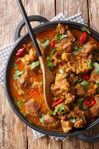 Indian spicy stew Lamb rogan josh closeup in a pan Wallpaper Mural