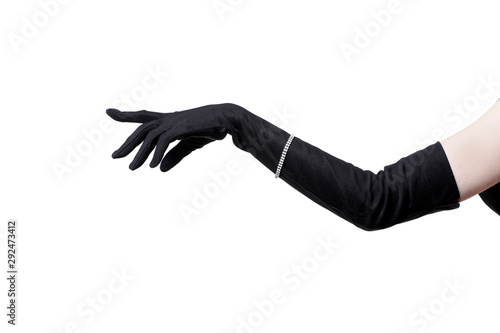 Photo Feminine hand in a black glove on a white background.