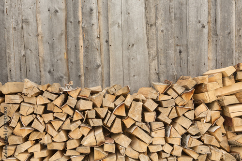 Woodpile - stack of wood. Firewood, sawn trees