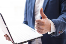 Businessman With Thumb Raised Making Ok Sign And Laptop