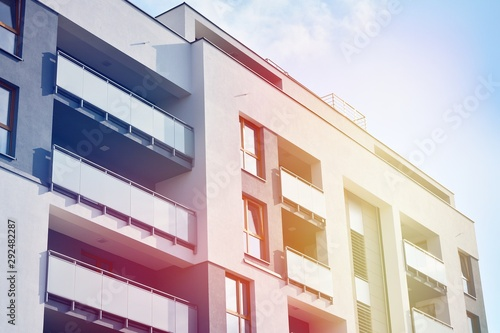Fototapety, obrazy: Modern apartment buildings on a sunny day with a blue sky. Facade of a modern apartment building.Glass surface with sunlight.