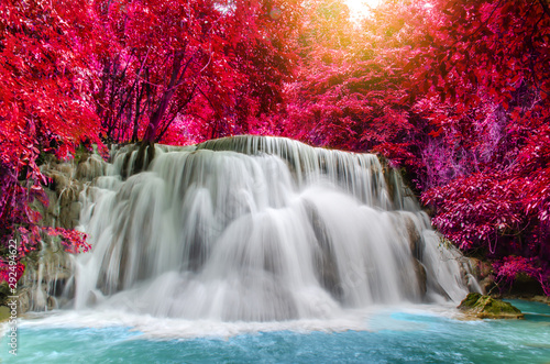 Travel to the beautiful waterfall in deep rainforest in autumn, soft water of the stream in the natural park at Huai Mae Khamin Waterfall in Kanchanaburi, Thailand.