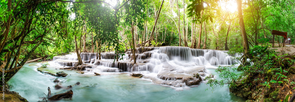 Fototapeta Travel to the beautiful waterfall in tropical rain forest, soft water of the stream in the natural park at Huai Mae Khamin Waterfall in Kanchanaburi, Thailand.