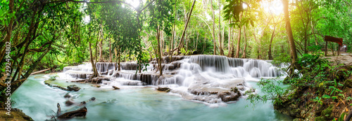 Travel to the beautiful waterfall in tropical rain forest, soft water of the stream in the natural park at Huai Mae Khamin Waterfall in Kanchanaburi, Thailand.