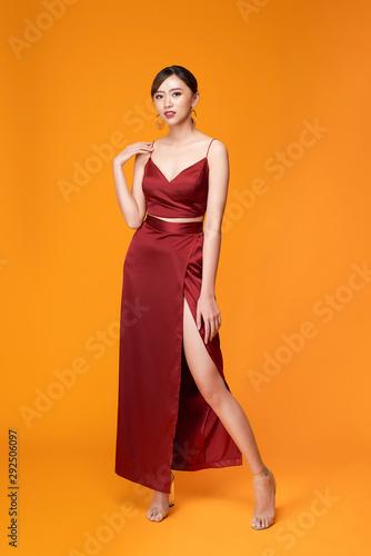 Fashion shot of the elegant woman in beautiful long dress posing in motion Wall mural