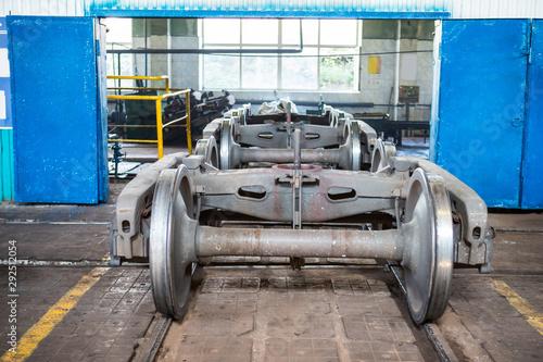 Wheel mechanism of railway cars in a repair depot Canvas Print