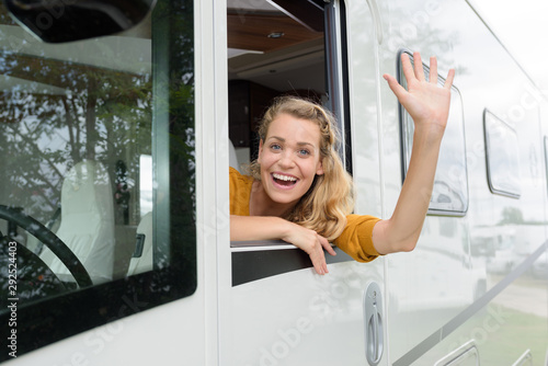 woman in the campervan waving Tablou Canvas