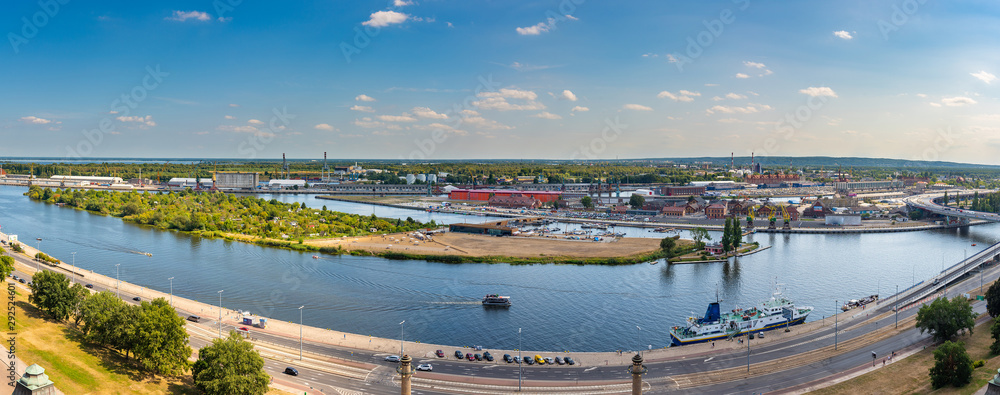 Fototapeta Left bank of the Oder river in Szczecin with the maritime museum and the terraces with a part of Grodzka Island, Szczecin, Poland