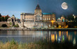 canvas print picture - Day and night view from across the river to the illuminated historic center. Odra river. Chrobry embankments in Szczecin