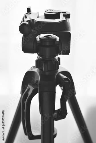 Fototapeta tripod for the camera on a white background obraz na płótnie