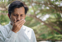 Halitosis , Young Asian Man Is...