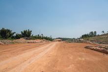 Wide Dirt Level Pavement Lands...