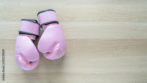 Valokuva Breast cancer awareness concept with pink boxing gloves for girl and woman sport