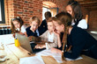 little boys and girls watching cartoon in the room wiith loft design, close up photo. education