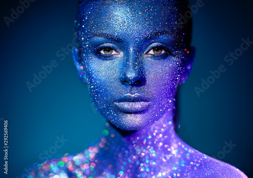 Fototapety, obrazy: Fashion model woman in blue bright sparkles and neon lights posing in studio. Portrait of beautiful sexy woman. Art design colorful glitter glowing make up