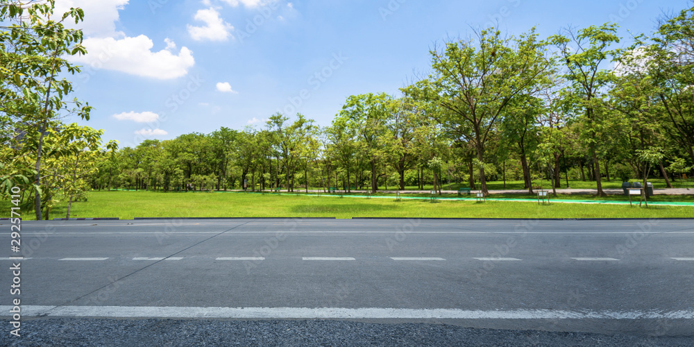 Fototapeta Empty highway asphalt road and beautiful sky in landscape green park