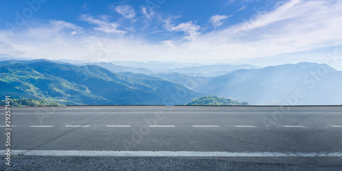 Poster Gris Empty highway asphalt road and beautiful sky mountain landscape