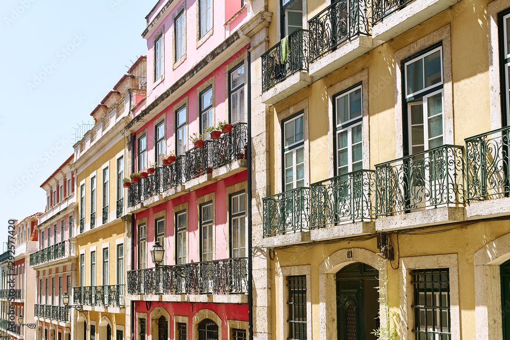 Fototapety, obrazy: Lisbon, Portugal - September 2, 2019: traditional buildings at the streets of old city