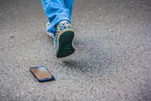 Woman Walking And Losing Her Smartphone. Girl Lost Her Smartphone, And Lost All Contacts