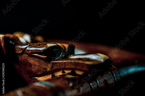 Photo sur Aluminium Marron Snake made of wood on a black background