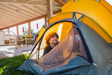 6 Year Old Boy Playing Inside  Yellow Tent At Sunset