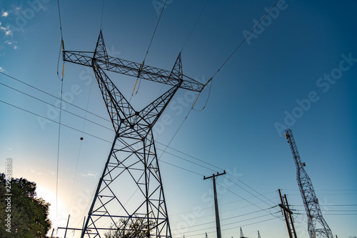 The towers and the power pole and the setting sun Wallpaper Mural