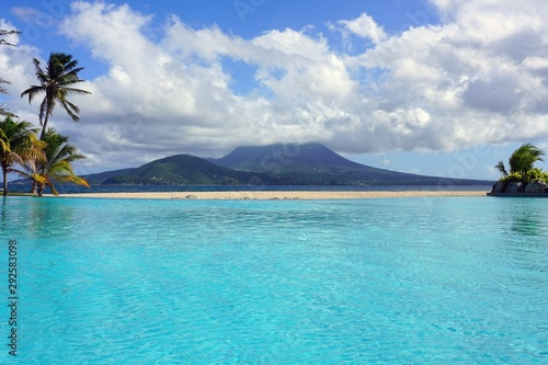 Day view of the Nevis Peak volcano across the water from St Kitts