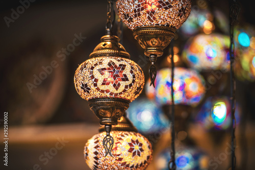 Oriental lamps in brass with colorful glasses during evening Canvas Print