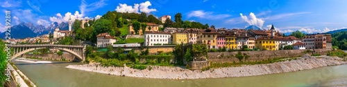 Breathtaking panorama of beautiful Belluno town surrounded by Dolomites mountains. Northen Italy