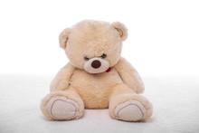 Teddy Bear On A White Carpet.