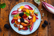 Autumn Salad With Roast Pumpkin, Chickory, Pecans And Goat Cheese