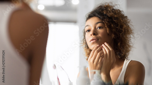 Black Millennial Girl Looking At Pimple In Bathroom, Panorama Canvas Print