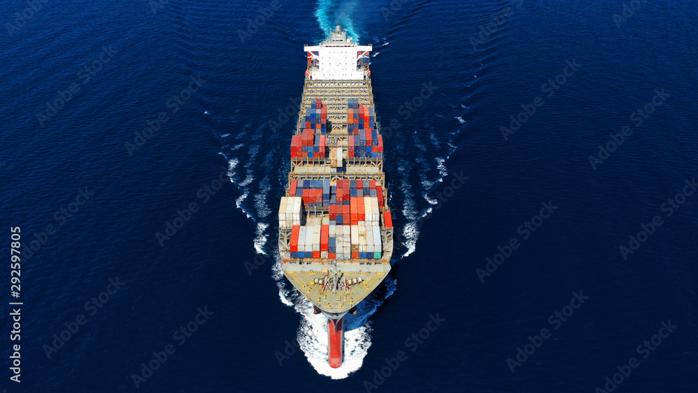 Aerial photo of large cargo container ship cruising the deep blue Mediterranean sea