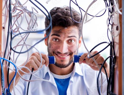 Fotografía Electrician trying to untangle wires in repair concept