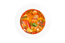 Closeup Top View Image Of A Plate Of Traditional Thai Soup - Tom Yum Kung Isolated At White Background.