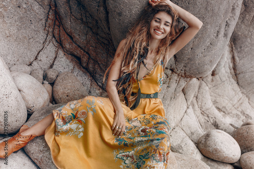 cheerful beautiful young boho style model on the stone beach Canvas Print