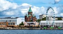 Beautiful Shot Of The Russian Orthodox Church And A Ferris Wheel In Helsinki, Finland
