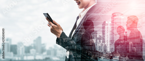Fototapeta Double Exposure Image of Business Communication Network Technology Concept - Business people using smartphone or mobile phone device on modern cityscape background. obraz
