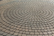 Brown Stone Pavers Set In Concentric Circles And Tilted Askew