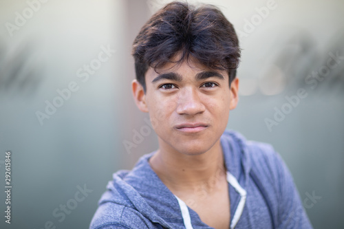 Fototapety, obrazy: Portrait of a handsome cocky young man next to the blurred background