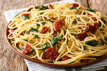 Traditional Spaghetti With Dried Tomatoes, Cheese And Spinach Close-up On A Plate. Horizontal