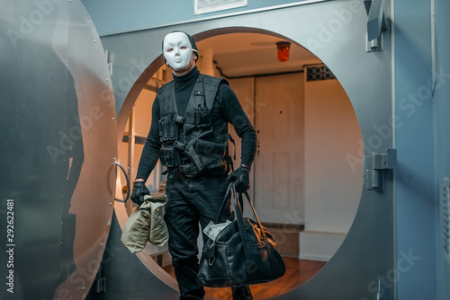 Fotomural Bank robbery, robber in black uniform and mask