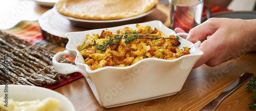 Obraz baked stuffing in casserole dish at thanksgiving dinner - fototapety do salonu