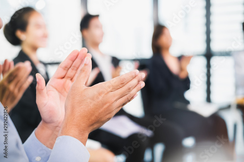 Carta da parati Young business people clapping hands during meeting in office for their success