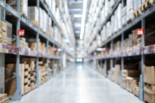 Obraz Warehouse inventory with packing box storage in factory. Logistic transportation storehouse concept. in blurred background. - fototapety do salonu