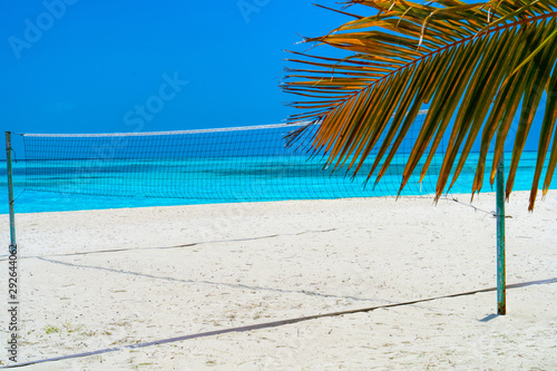 Volleyball net on a deserted sandy beach on the tropical sea.
